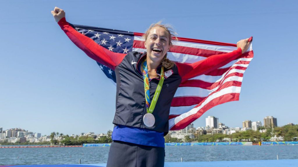 Gevvie celebrates with her silver medal and US flag.  Photo courtesy of Ed Hewitt/row2k/USRowing